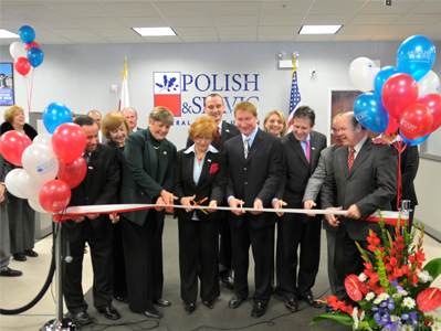 M. Fryzel and members of PSFCU Board of Directors cut the ceremonial ribbon at the Mt. Prospect branch
